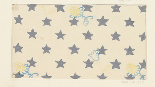 Pattern of gray stars on white ground, with four floral motifs in blue and yellow.
