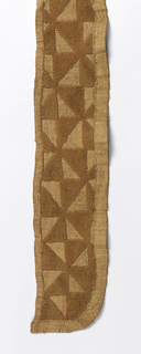 Long narrow band made from three shorter pieces stitched together. Embroidered pile in natural raffia color in repeating pattern of rotated triangles.