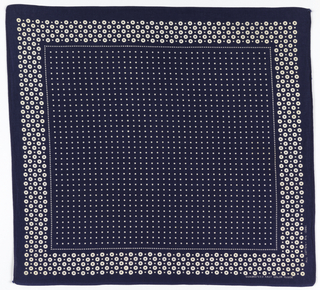 Square bandana with a deep blue ground and a field of small white dots; border of larger white dots with blue centers.