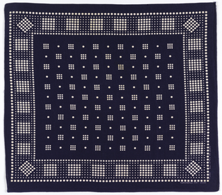 Square bandana with deep blue ground. Field of small white dots grouped to form squares alternating with single dots. Border with two sizes of white dots, some clustered to form squares and others forming the background.