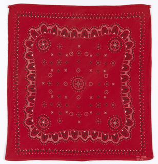 Square bandana with a bright red ground and design in white and black. A lace-like border surrounds a field with a circular medallion in the center and each corner of the field; other small circular forms are arranged in a circular formation.