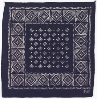 Square bandana with a deep blue ground. Field of concentric white diamonds alternating with small solid diamonds. Deep border of diamonds superimposed on squares. Narrow outer border of interlocking triangles.