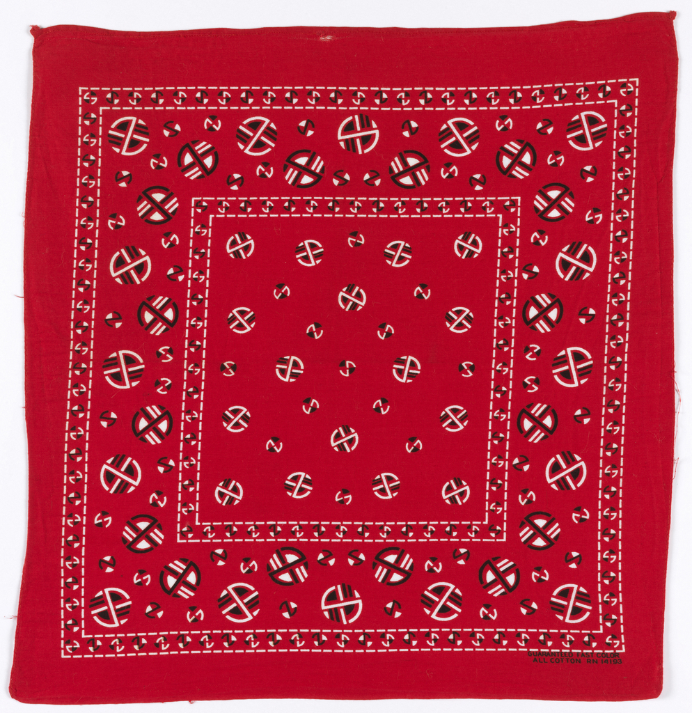 Square bandanas: a has red ground with design in black and white; b has deep blue ground with design in white. Field with scattered circular motifs of Art Deco design. Deep border with larger versions of same motifs. Narrow borders around field and outer edge of design.