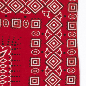 Square bandanas: a has red ground with design in black and white; b has blue ground with design in white. Design of concentric borders, each made up of concentric diamonds, squares and ovals.