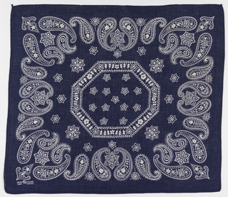 Square bandanas: a has a red ground and design in black and white; b has deep blue ground and design in white. Octagonal center field filled with small flowers, surrounded by a deep frame of paisley botehs with decorative filllings.