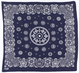 Square bandanas: a has red ground and design in black and white; b has blue ground with design in white. Circular center medallion filled with small flowers, surrounded by a field of small circular medallions. Deep border of circles filled with decorative patterns.