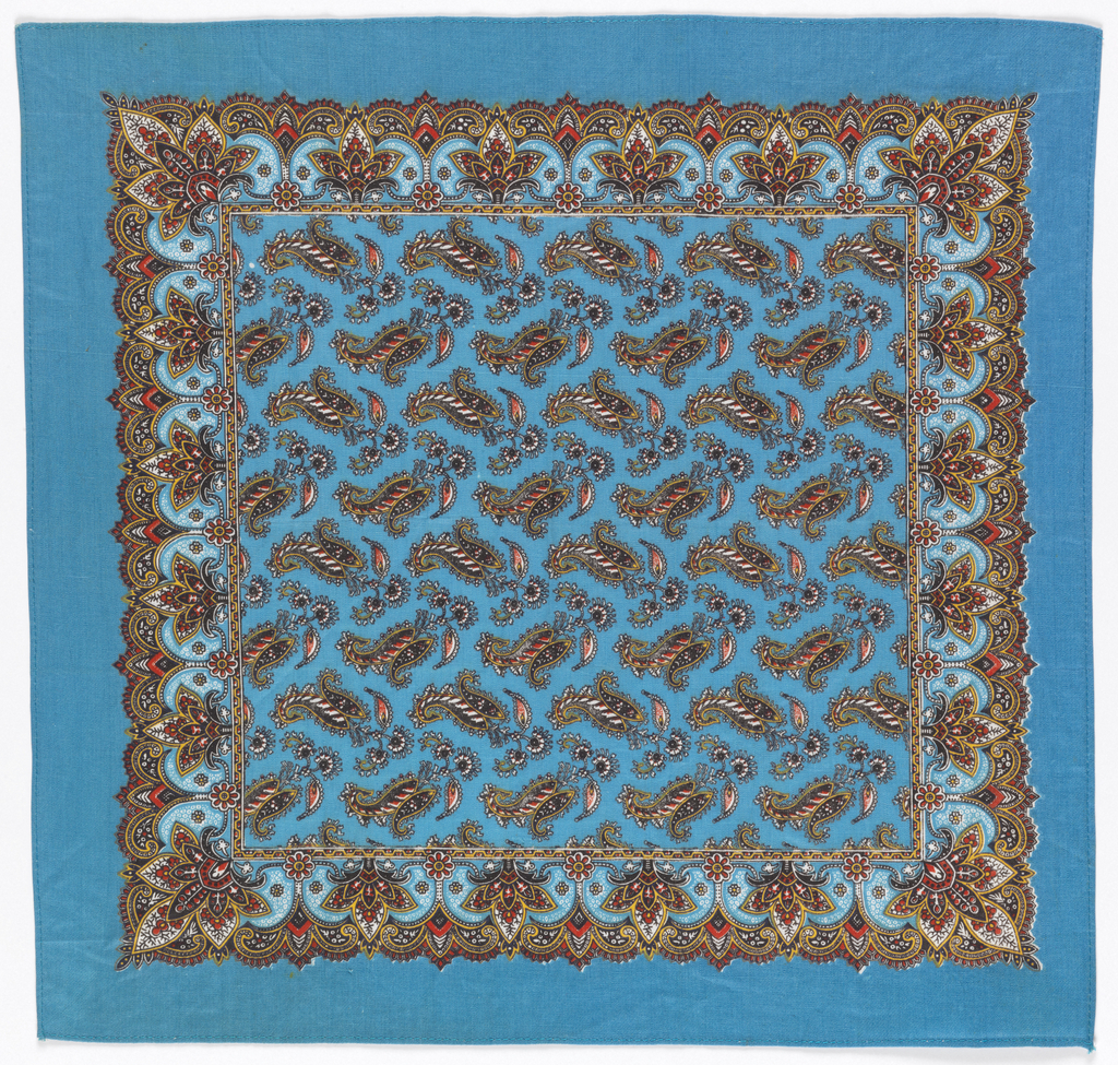 Square handkerchief with a field of paisley shapes facing in alternating directions and a floral border. In black, white, red, and yellow on a turquoise blue ground.