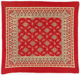 Square bandana with a red ground and design in white and pale gray. The field has a lattice design of flower-filled diamonds. The border resembles a dagged lace with flowers in each triangle.