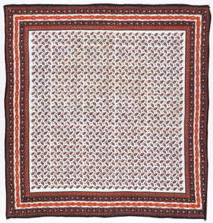 Square bandana with a white ground and design in black, red and blue. Field of closely-space paisley forms. Five narrow geometric borders.