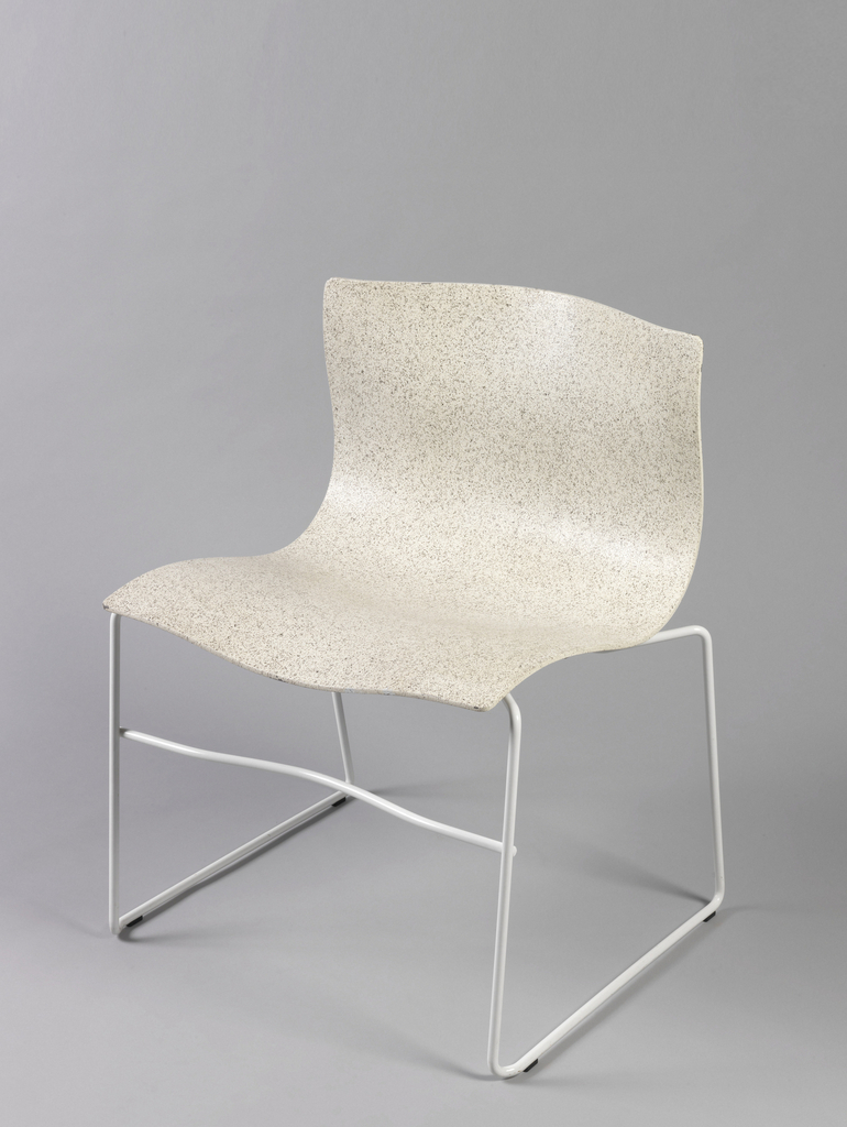 Curved back and seat made of a single gray-white metal sheet with slight ripples throughout (like a handkerchief) mouned on a rectalinear white tubular metal base with a stretcher spanning the front legs.