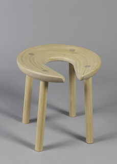 Horseshoe-shaped seat made from laminated birch; four post legs.