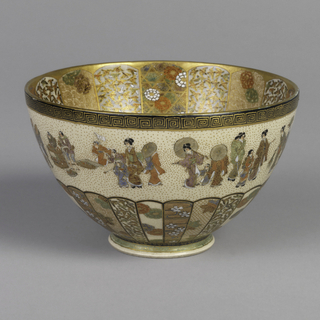 Bowl with flared foot. On ground of cream-colored small crackle glaze, decoration in Satsuma style. Chrysanthemum near base with multi-colored brocaded patterns of birds and floral motifs in the panels. Continuous band of city street scenes with design at rim. Interior: center reserve of women and children, surrounded by fret band. Repetition of exterior chrysanthemum motif with great elaboration.