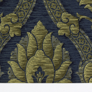 Textile-based, large scale pine motif in center of ogee-shaped bands or diaper. Printed in dark blue, light blue, brown, light beige and grey.