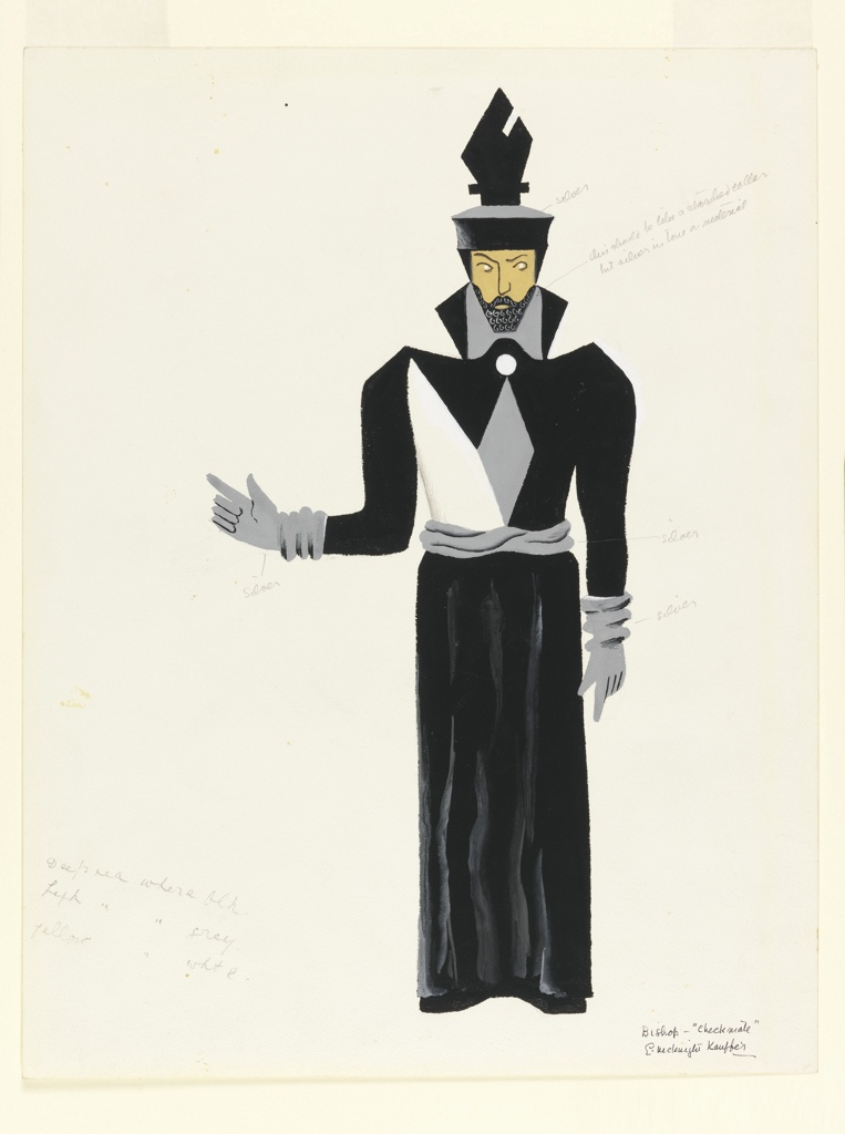 Costume design in black, gray, and white for a bishop. Figure standing frontally, with black beard, right hand pointing out to the side, wearing a black hat in the shape of a spade, with silver gloves, silver belt, and long black tunic.