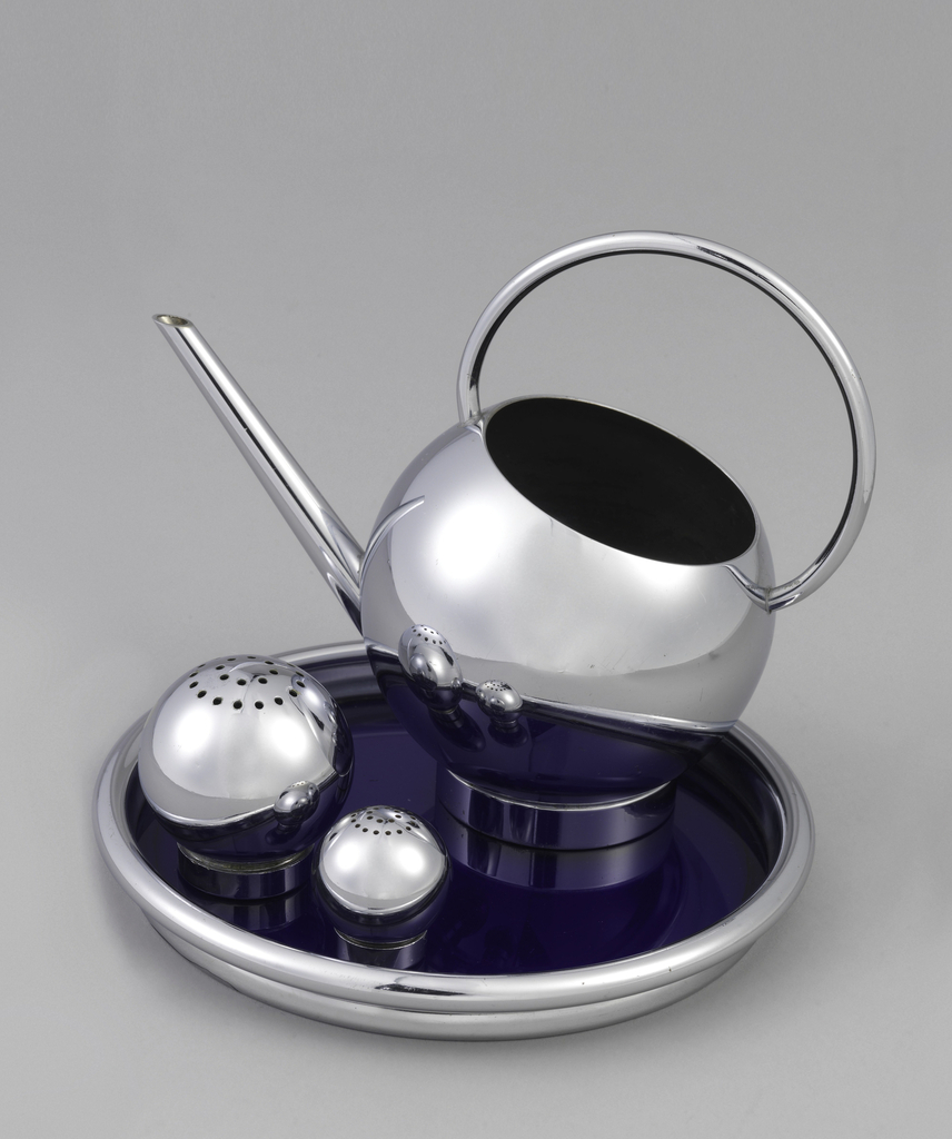 Four piece set. Salt and pepper shakers (c/d and e/f): chrome sphere resting on a circular base that can be unscrewed for filling the containter; the top punctured with holes forming two circles. Tray (a): chrome and circular with a blue-colored glass lining and a chrome-plated rim. Pitcher (b): spherical chrome container resting on a circular base, the upper right portion of the sphere chamfered, a solid semi-circular handle extends from one side of the opening to the other, with a long thin spout projecting upwardly soldered to the body.