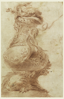 Vertical rectangle. In the general shape of a pitcher. As foot serves a mole and branches. The body it ovoid and decorated with festoons. The snakes form a handle, below the spout. On the opposite side of the neck above is a head. Upon the cover are two dolphins.
