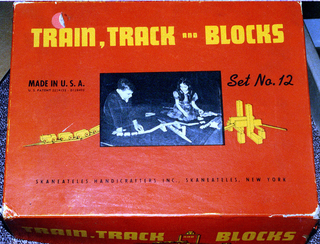 vehicle, toy railroad set. Accessories:  two part original box with separator; 8 page instruction manual;  2 piece catalog sheet with price list; envelope with 43 metal connecting pins.