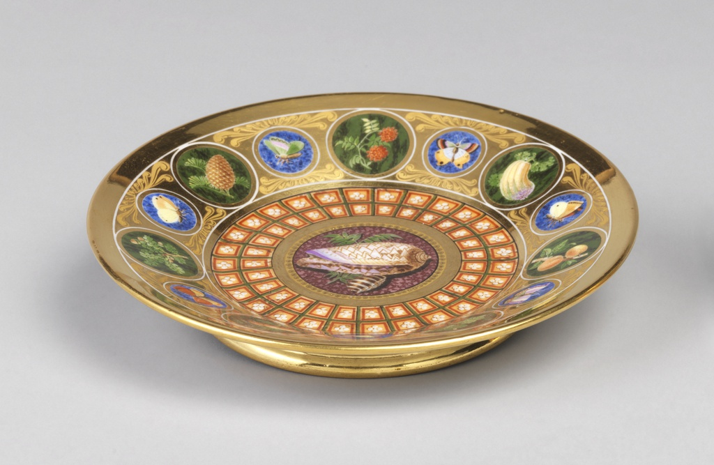 Circular form with alternating large roundels of fruit on faux malechite background.  Smaller roundels of butterflies on lapis background.  Center contains a shell on a marbelized background surrounded by a coffered pattern.