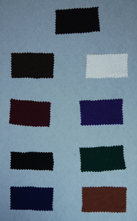 """25  (17?) swatches in solid colors with designs in relief.  Several [-m,-n,-p] have metal threads running through the ground. a-i) woven with vertical ribs and looping calligraphic lines. a- dark brown; b- light brown; c- maroon; d- black; e- navy blue; f- white; g- purple; h- burnt orange; i- green j,k,) woven with vertical ribs and diagonal cross hatching marks; j- brown; k- black m,n,p) woven """"dots"""" with gold metallic wefts; m- brown; n- periwinkle blue; p- teal o,q,r) plain weave with warp floats and """"dots""""; o- navy blue; q- black; r- white"""