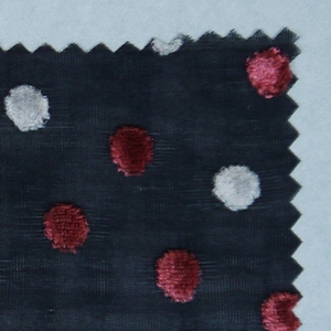 Black ground with velvet polka dots in pink and white.