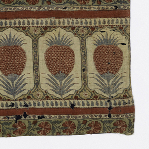 Cover printed in a design of flowers and pineapples in reds, blues, and tans. Two strips stitched together form cover.