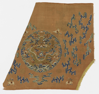 Fragment of silk tapestry in pale orange with one roundel containing a 5-claw gold dragon surrounded by blue cloud bands.