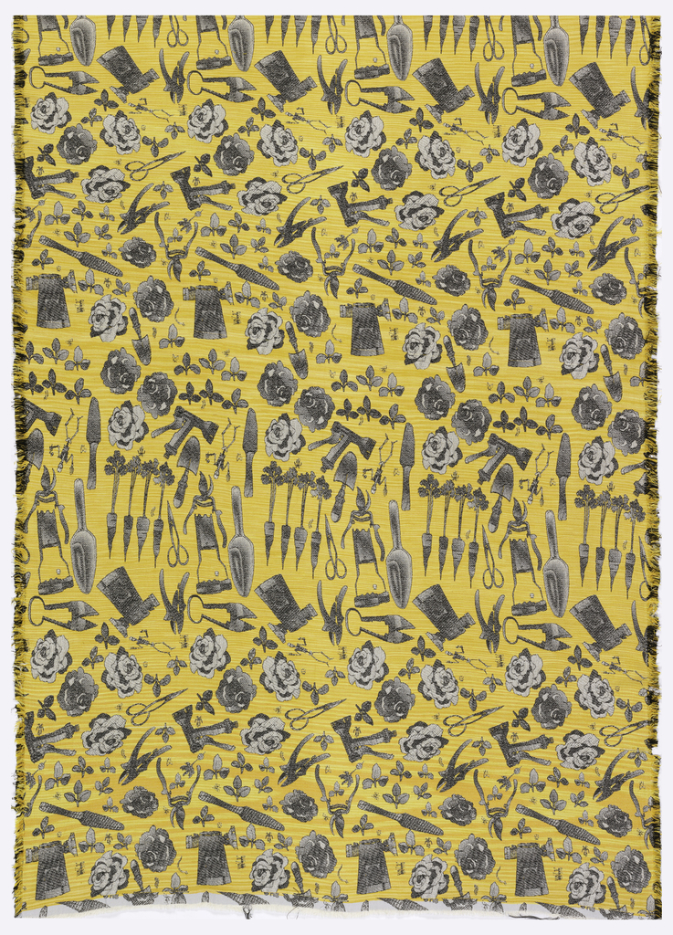 Woven textile with gardening tool interspersed with carrots, flowers, leaves, skeletons and insects, rendered in black and white on a yellow ground.