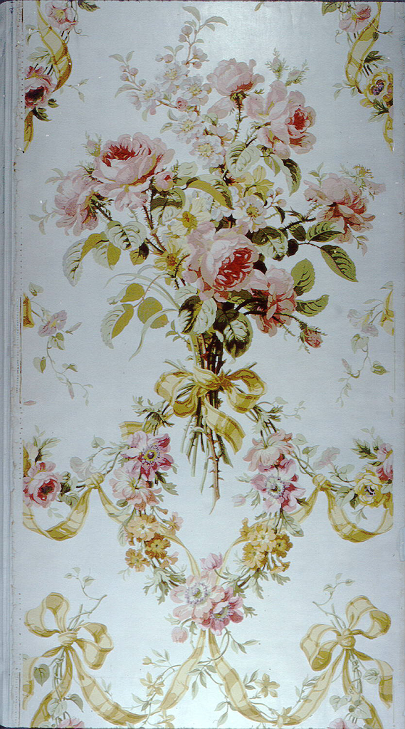 A cluster of large scaled pink roses tied with yellow ribbon is the major motif. Yellow ribbon also connects the latter with sprays of anemones and morning glories. Drop repeat. Printed in eighteen colors on glazed white ground.