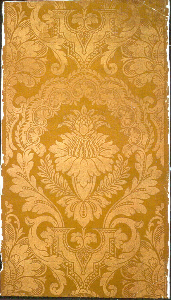 Heavy bisymmetrical flower and leaf design. Straight across match. Shiny brown flock on dull brown flock ground.