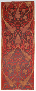 Length of deep red velvet with a symmetrical design of ogees formed by long scalloped leaves emerging from large flower heads, in silver gilt twill. Delicate twining stems, leaves and flowers in red satin weave fill the background.