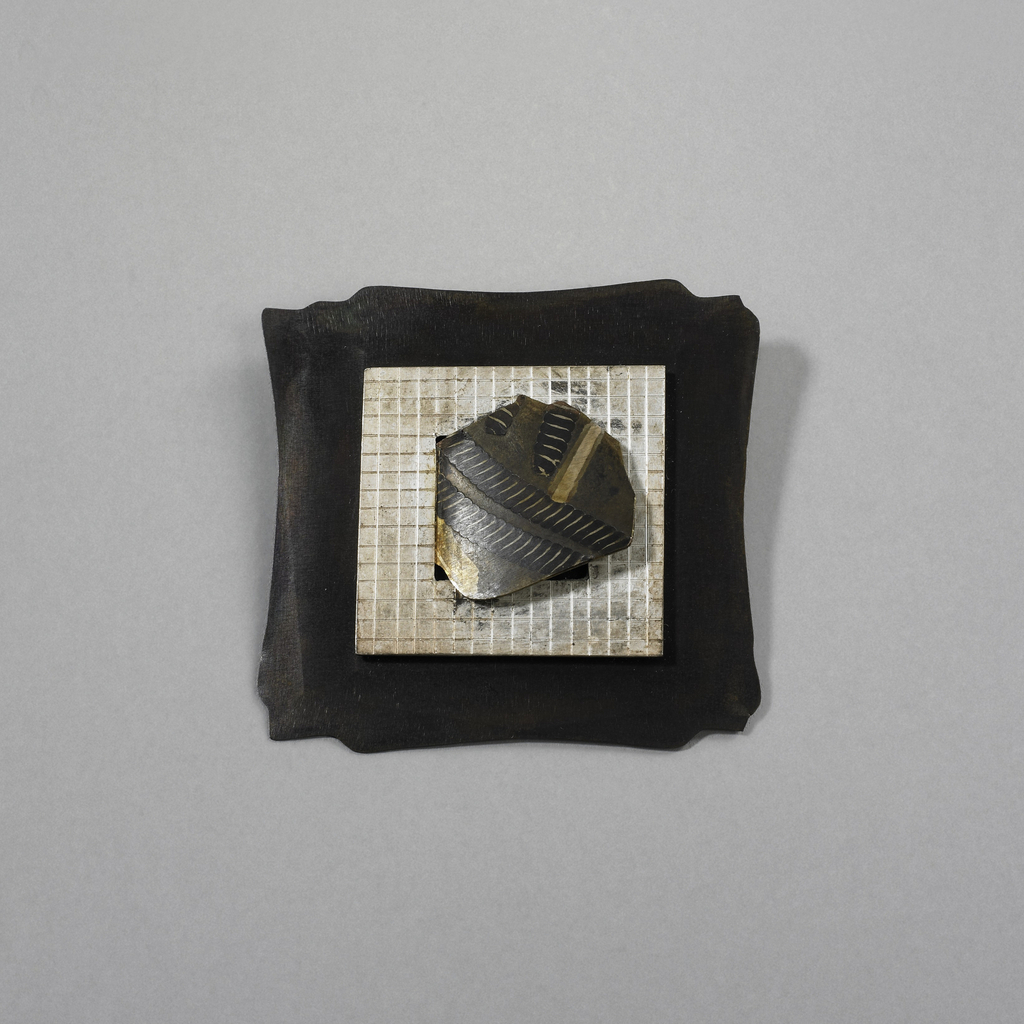 Flat brooch is square, with base of hammered patinated sheet copper with irregular edges. Applied over base is square of silver engraved with grid pattern. Center of silver pierced with square; applied over piercing is irregular form etched, engraved and patinated with abstract designs. Pin clasp soldered to reverse.