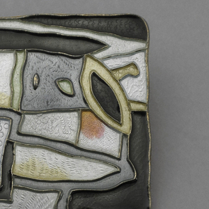 Rectangular polychrome enameled brooch decorated with abstract shapes.