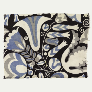 Large scale stylized floral pattern in white, blue, and light gray on a black ground.