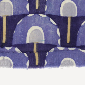 Horizontal stripe with pattern of umbrellas (?) in dark blue, light blue, light gray, yellow and ivory.