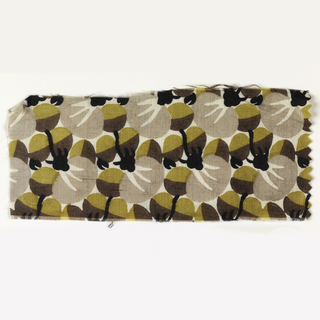 All-over abstracted floral in black, dark brown, taupe, and puce on an ivory ground.