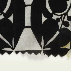 Geometric pattern including vine with pointed leaves; in black on white.