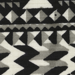 Geometric pattern of diamonds, triangles and zigzags in black, gray and white.