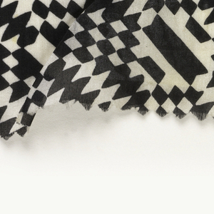 Geometric pattern of zigzags and diamonds in black on white.