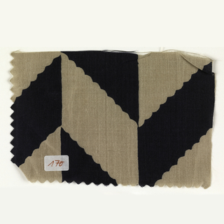 Large-scale off-set chevron stripe in taupe and black.