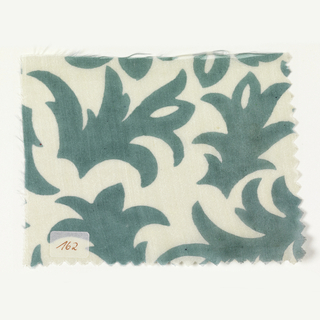 Stylized vegetal forms in light green on ivory.