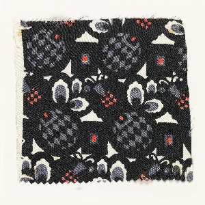 Pattern of pineapple-like forms, thickly outlined in black, with black and gray diamond filling and gray and white leaves, interspersed with squares of pink and black diamonds.