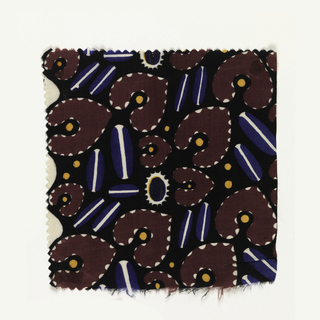 Abstract pattern with violet spade-like shapes with yellow centers and white scallops at edges; blue ovals with white stripes down the center, and yellow dots on a black ground.