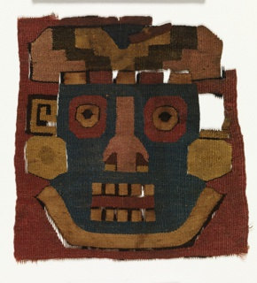 Two fragments of very fine tapestry weave with cotton warps and wool wefts. A) Face of a man or god, conventionalized and angular in blue, red, tan, black and brown.
