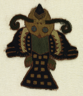 Winged bird or fish-like monster embroidered in strong colors.