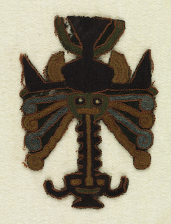 Figure wearing a mask with many appendages and trophy head.  Embroidered in strong colors.