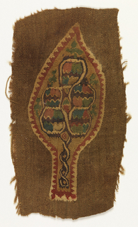 Tapestry woven fragment showing a leaf shape on a dyed brown ground. At center, interlacing lines form a tree shape.