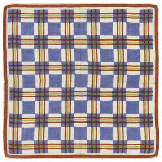 Blue and white check overlaid with red and green grid. Narrow red border and rolled hems.