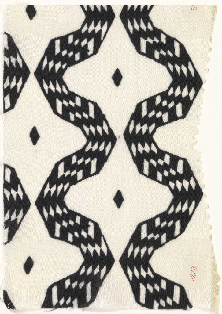 Abstract geometric pattern in black and white, with jagged meanders filled with black and white harlequin, forming four-pointed white stars with black centers.
