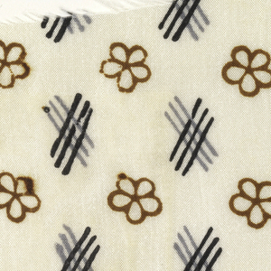 Small-scale pattern of flowers and cross-hatches in gray, navy and brown on an ivory ground.