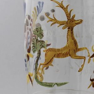 Large clear glass beaker with painted decoration of a stag.